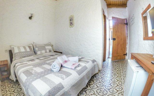 Отель Afet Hanim Konagi Чешме комната для гостей