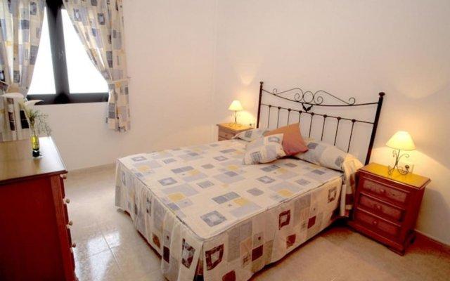 Апартаменты Cala Apartments 3Pax Bajo A Гинигинамар комната для гостей