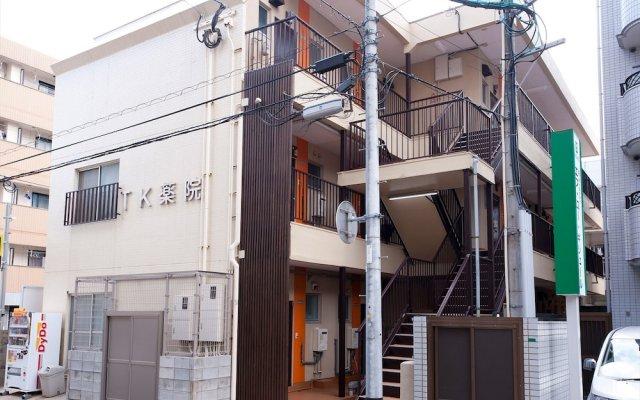 Отель Aruko Residence Yakuin Фукуока вид на фасад