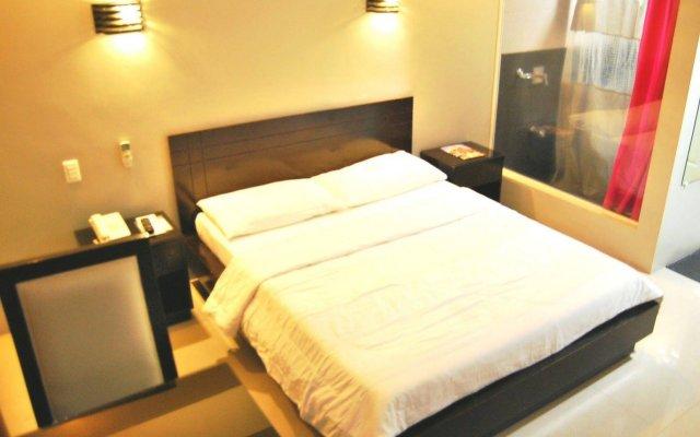 Отель Rumi Apartelle Hotel Филиппины, Пампанга - 1 отзыв об отеле, цены и фото номеров - забронировать отель Rumi Apartelle Hotel онлайн вид на фасад