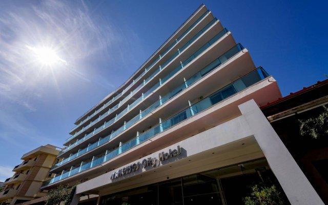 Manousos City Hotel вид на фасад