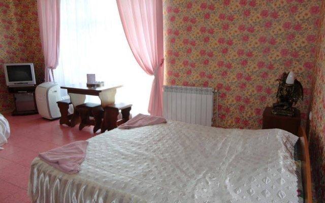 4 Сезона Отель комната для гостей