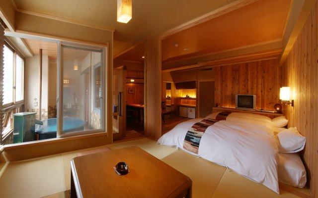 Отель Yumeminoyado Kansyokan Синдзё комната для гостей