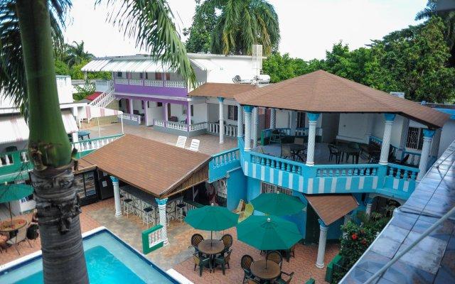 Отель Gloriana Hotel Ямайка, Монтего-Бей - отзывы, цены и фото номеров - забронировать отель Gloriana Hotel онлайн вид на фасад