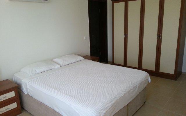 Отель Вилла Paradise Kalkan Villalari комната для гостей