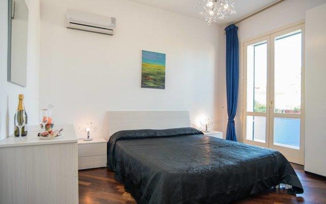 Отель Deluxe Apartment in Villa Pantarei Италия, Поццалло - отзывы, цены и фото номеров - забронировать отель Deluxe Apartment in Villa Pantarei онлайн комната для гостей