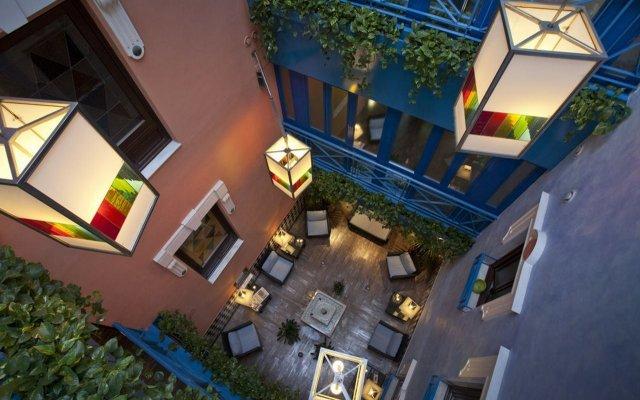 Отель Suites Gran Via 44 Apartahotel вид на фасад