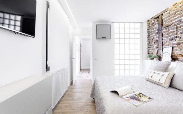 Апартаменты Santa Ana Apartment by FlatSweetHome Мадрид комната для гостей