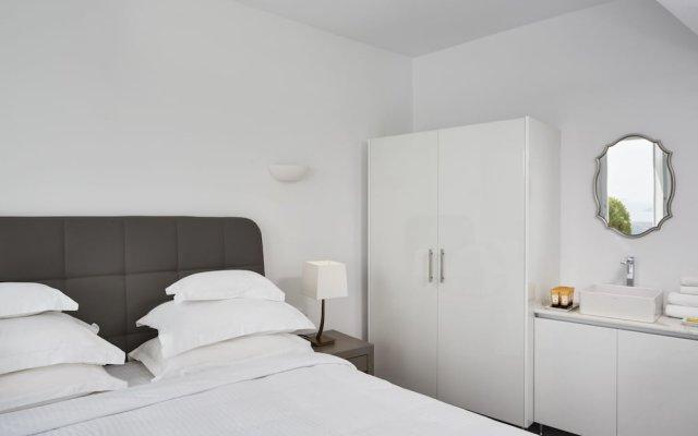 Отель Eden Villas By Canaves Oia комната для гостей