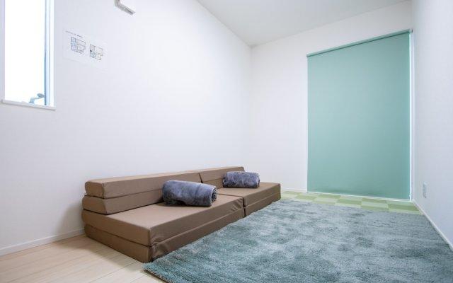 Отель AMP FLAT Yoshizuka Фукуока комната для гостей