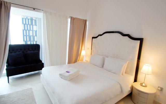 Отель Kennedy Towers - Cayan Tower 2 Bed комната для гостей