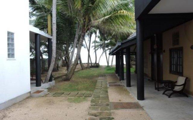 Отель Turtles Rest and Curry Bowl вид на фасад