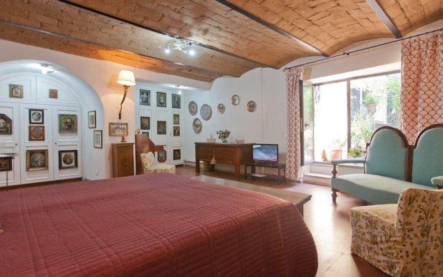 Апартаменты Rental in Rome Arco Ciambella Studio Рим комната для гостей