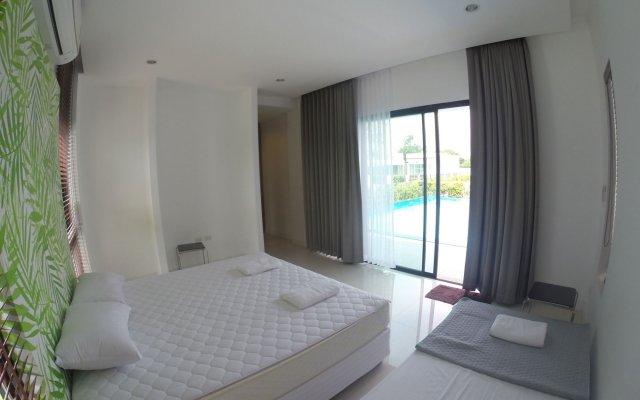 Отель Villa Ozone Pattaya комната для гостей