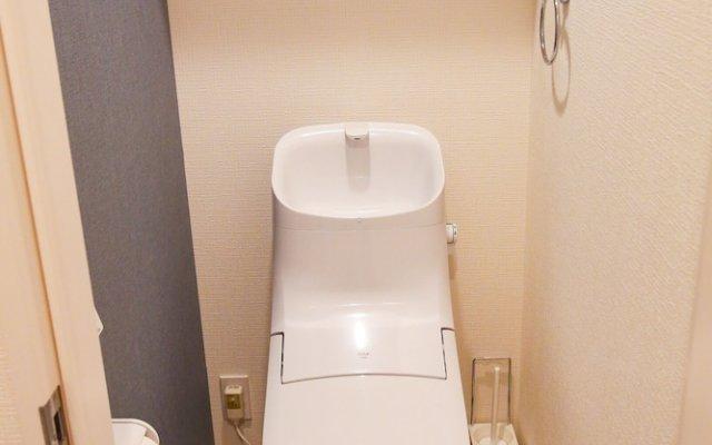 Отель Tenjin Higashi Russo Порт Хаката ванная