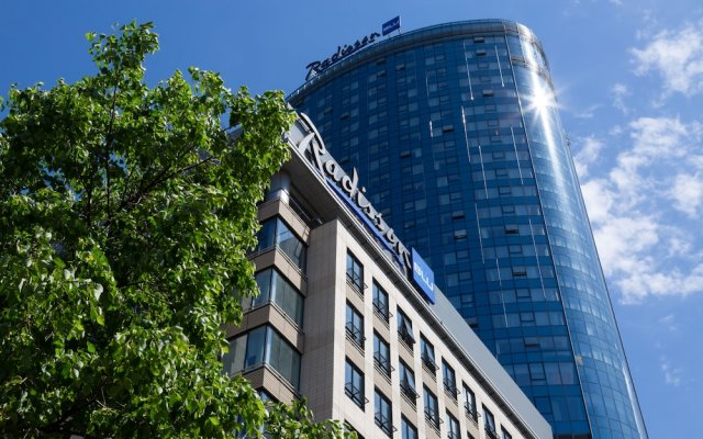 Radisson Blu Olympiyskiy Hotel Москва вид на фасад