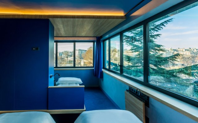 Отель Hôtel Yooma Urban Lodge комната для гостей