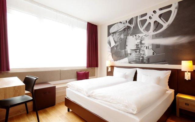 Отель Vienna House Easy München Германия, Мюнхен - 1 отзыв об отеле, цены и фото номеров - забронировать отель Vienna House Easy München онлайн комната для гостей