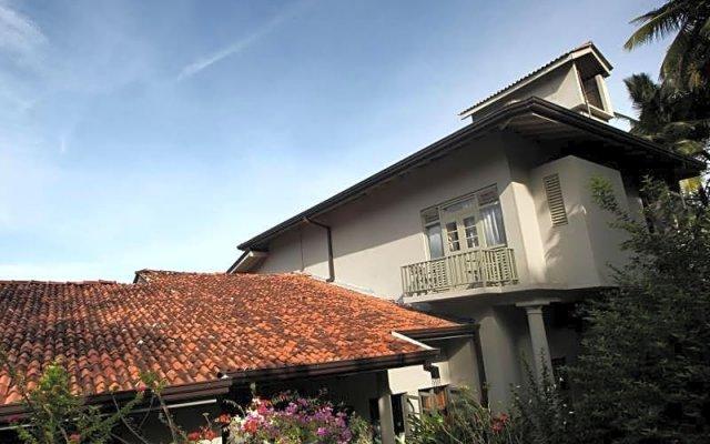 Отель Hibiscus Villa вид на фасад
