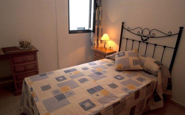Апартаменты Cala Apartments 3Pax Bajo D Гинигинамар комната для гостей