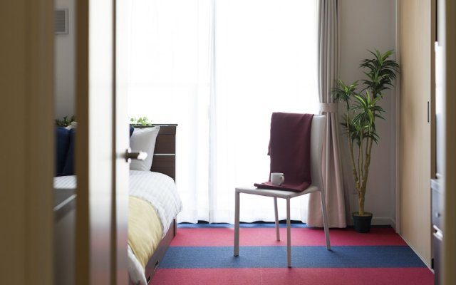 Residence Hotel Hakata 18 Фукуока комната для гостей