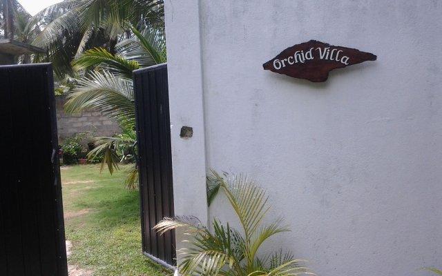 Отель Orchid Villa 10 вид на фасад