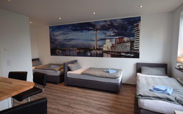 Отель Ferienwohnung Düsseldorf комната для гостей