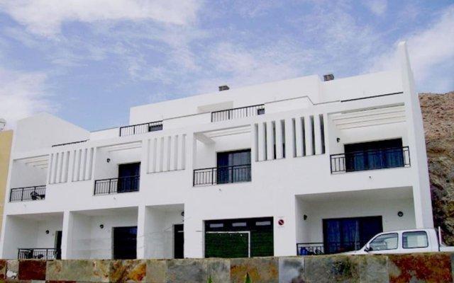 Отель Cala Apartments 3Pax 1A Испания, Гинигинамар - отзывы, цены и фото номеров - забронировать отель Cala Apartments 3Pax 1A онлайн вид на фасад