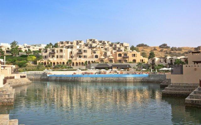 Отель The Cove Rotana Resort