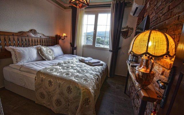 Ayse Hanim Konagi Турция, Урла - отзывы, цены и фото номеров - забронировать отель Ayse Hanim Konagi онлайн комната для гостей