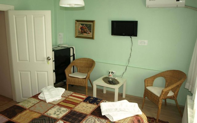 Апартаменты Midillis Art Apartment комната для гостей