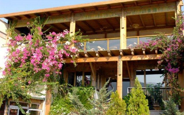 Happy Hotel Kalkan Турция, Калкан - отзывы, цены и фото номеров - забронировать отель Happy Hotel Kalkan онлайн вид на фасад