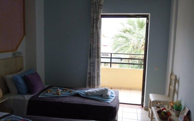 Minoa Hotel комната для гостей