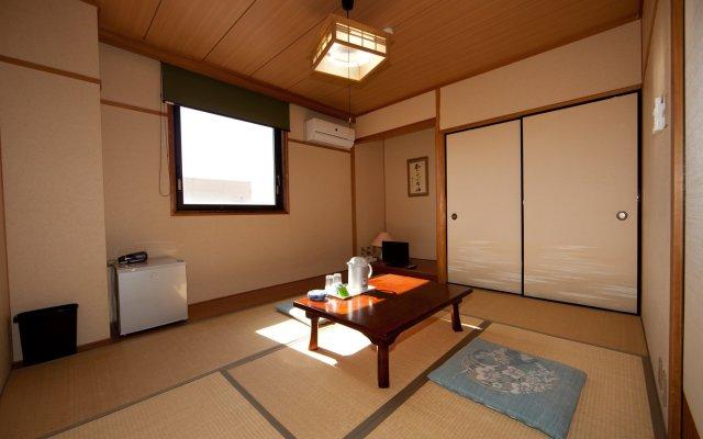 Отель Business Hotel Pocket Япония, Минамиавадзи - отзывы, цены и фото номеров - забронировать отель Business Hotel Pocket онлайн комната для гостей