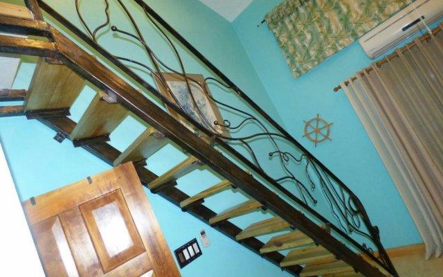 Отель Fisherman's Point Holiday Ямайка, Очо-Риос - отзывы, цены и фото номеров - забронировать отель Fisherman's Point Holiday онлайн вид на фасад