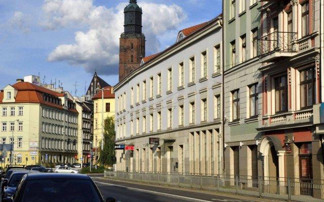 Отель SleepWalker Boutique Suites вид на фасад