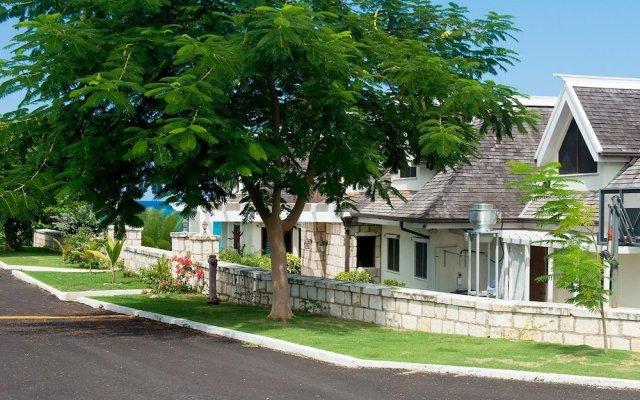Отель Tallawah Villa, Silver Sands Jamaica 7BR вид на фасад