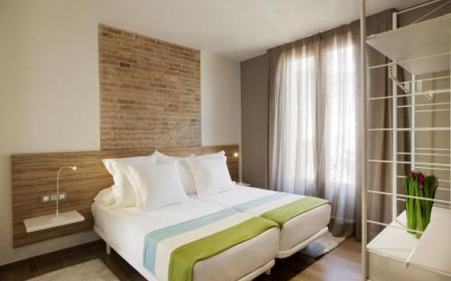Отель Milà Apartamentos Barcelona комната для гостей