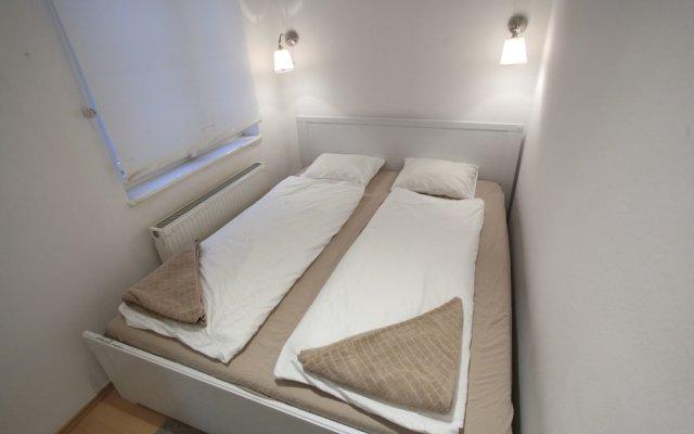 Апартаменты Dfive Apartments - Aranykez комната для гостей