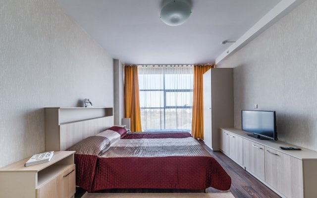 "Апартаменты ""Салют Плюс"" комната для гостей"