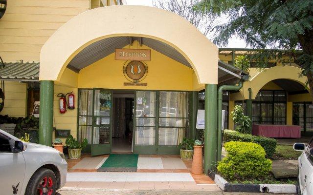Отель Jumuia Guest House Nakuru Кения, Накуру - отзывы, цены и фото номеров - забронировать отель Jumuia Guest House Nakuru онлайн вид на фасад