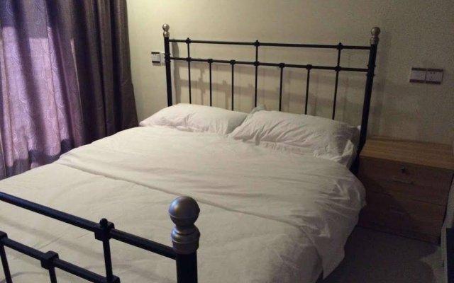 Апартаменты Xingfu Huafu Apartment комната для гостей