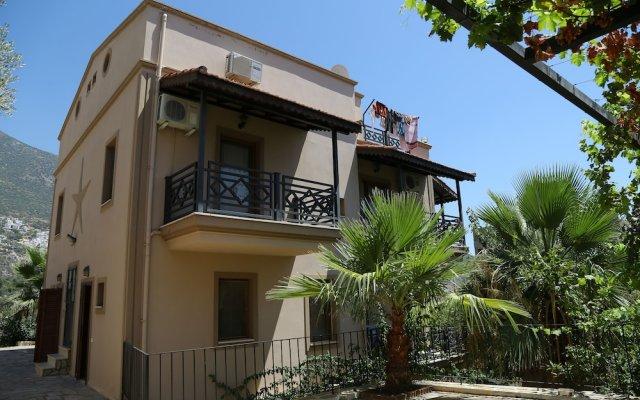 Kalkan Koc Apart Турция, Калкан - отзывы, цены и фото номеров - забронировать отель Kalkan Koc Apart онлайн вид на фасад