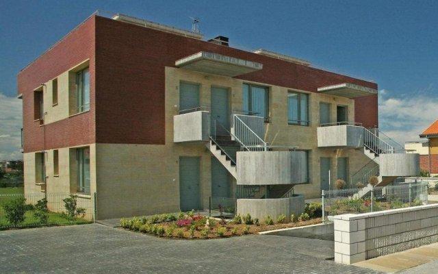 Отель Apartamentos Playa de Portio Испания, Пьелагос - отзывы, цены и фото номеров - забронировать отель Apartamentos Playa de Portio онлайн вид на фасад