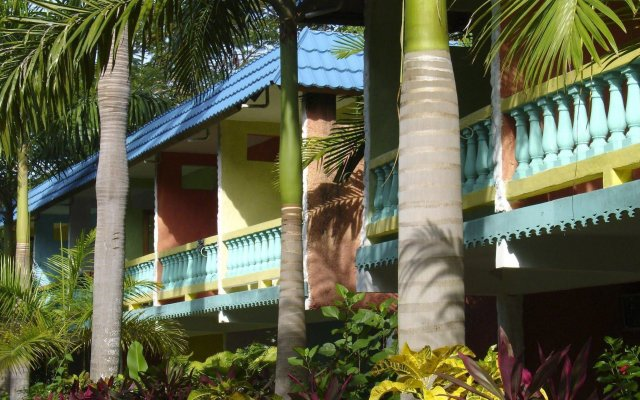 Отель Legends Beach Resort Ямайка, Негрил - отзывы, цены и фото номеров - забронировать отель Legends Beach Resort онлайн вид на фасад