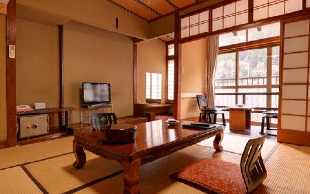 Отель Tsuetate Onsen Izumiya Минамиогуни комната для гостей