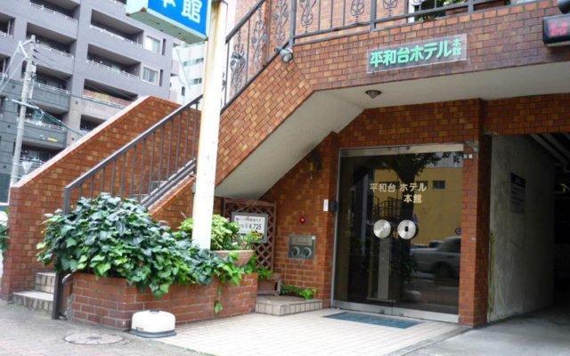 Отель Heiwadai Hotel Honkan Япония, Фукуока - отзывы, цены и фото номеров - забронировать отель Heiwadai Hotel Honkan онлайн вид на фасад