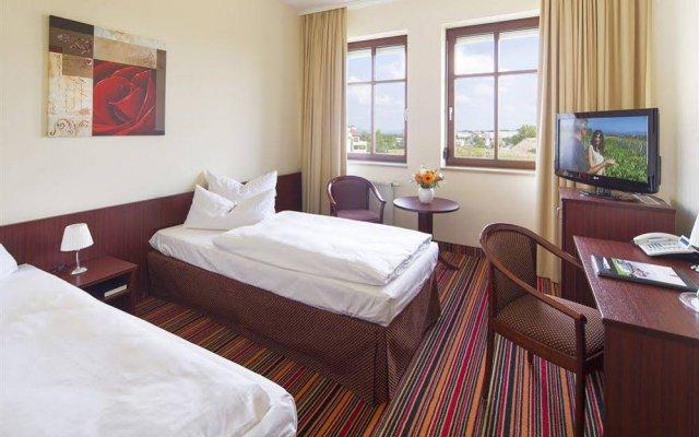 Kim Hotel Dresden комната для гостей