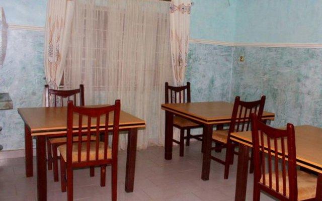 Отель Specs Suite Нигерия, Калабар - отзывы, цены и фото номеров - забронировать отель Specs Suite онлайн питание