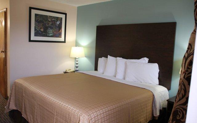 Отель Knights Inn Niagara Falls Near IAG Airport США, Ниагара-Фолс - отзывы, цены и фото номеров - забронировать отель Knights Inn Niagara Falls Near IAG Airport онлайн комната для гостей